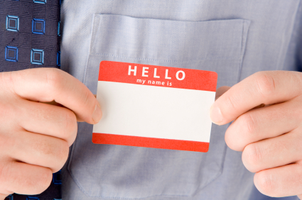 Businessman Attaching Name Tag